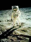 Astronaut Buzz Aldrin walking on the moon's surface during the Apollo 11 mission on July 20, 1969.