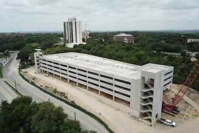 Photos from June 2019 show an updated look at the San Antonio Zoo's new parking garage which is expected to open in October.