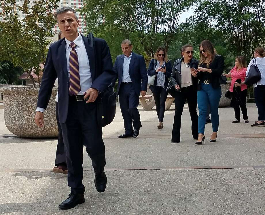 Rafael Enrique Rodriguez, front left, leaves San Antonio's federal court during a break in his trial on Thursday, June 6, 2019. Prosecutors allege that Rodriguez, through his 210Workers physical therapy clinics, defrauded the federal workers' comp program out of millions of dollars. Photo: Guillermo Contreras / Staff
