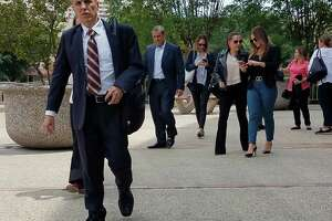 Rafael Enrique Rodriguez, front left, leaves San Antonio's federal court during a break in his trial on June 6. Prosecutors alleged that Rodriguez defrauded the federal workers' comp program out of millions of dollars through his physical therapy clinics. Friday, a jury found him guilty.