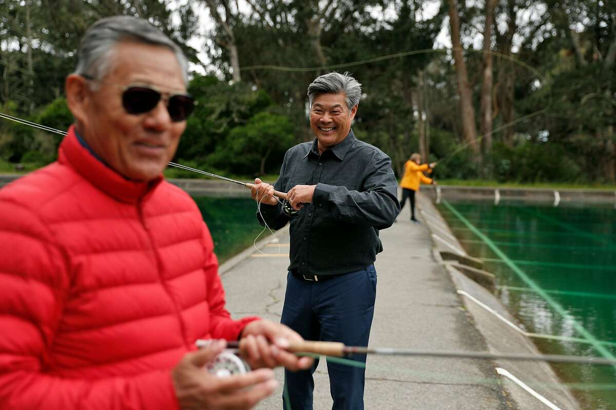 New San Francisco Chamber of Commerce President and CEO, Rodney Fong, center, with his mom and dad, Bev and Ron Fong at the casting ponds in Golden Gate Park in San Francisco, Calif., on Wednesday, May 15, 2019.