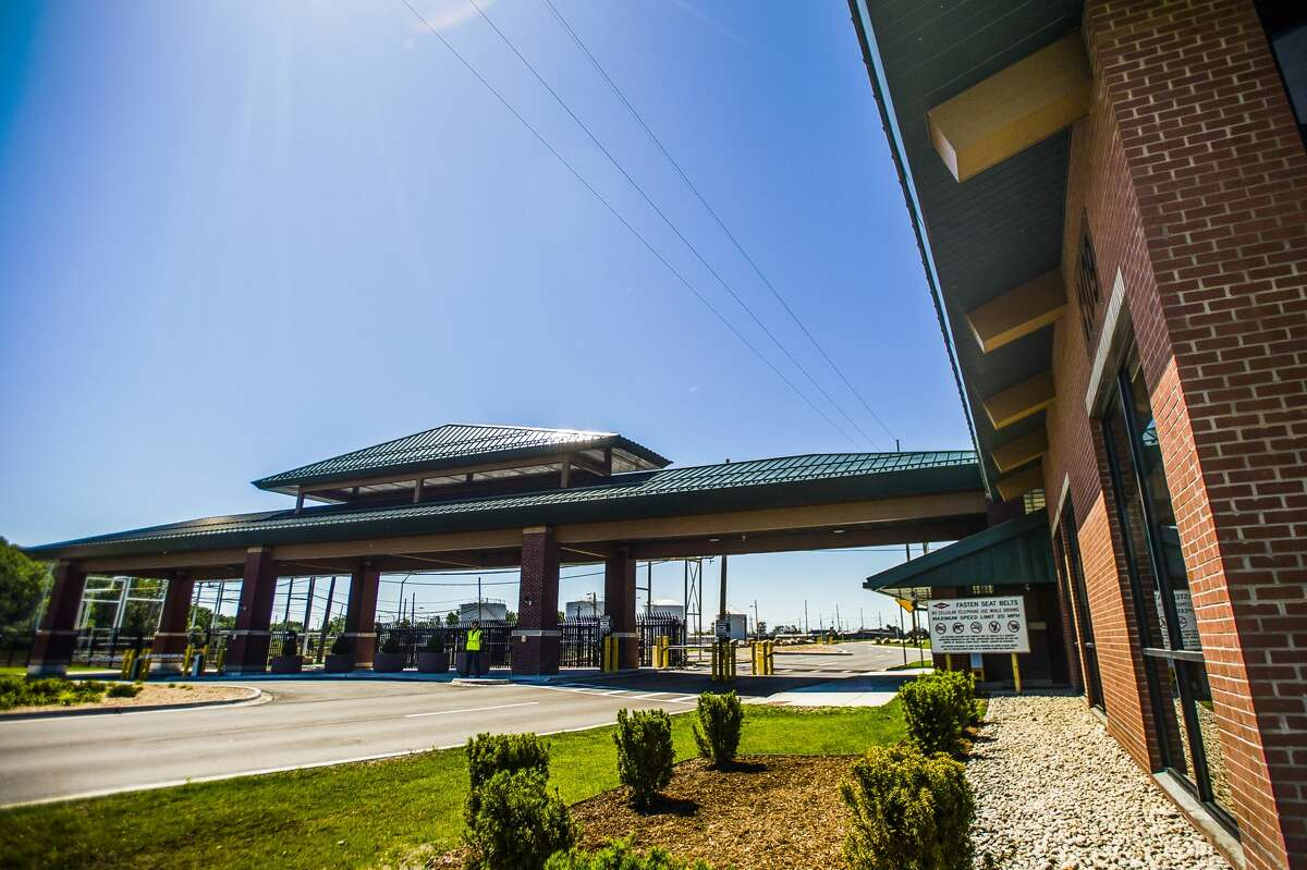 Guests tour the Michigan Operations I-Park's new gatehouse entrance facility during a ribbon cutting event on Thursday, June 20, 2019 in Midland. (Katy Kildee/kkildee@mdn.net)