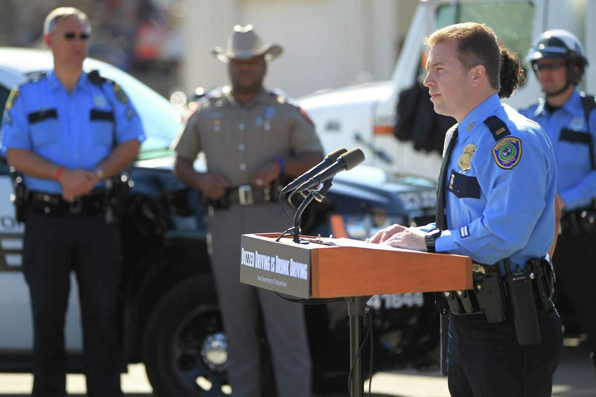 Houston police officials speak to the media about the Texas Department of Transportation's Buzzed Driving Campaign in 2013.