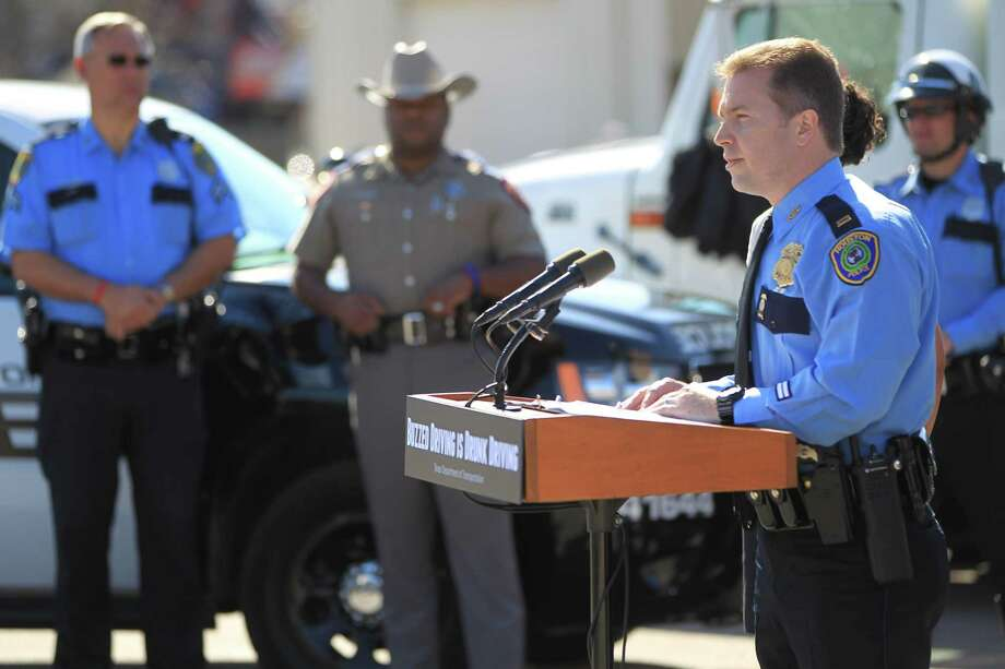 Houston police officials speak to the media about the Texas Department of Transportation's Buzzed Driving Campaign in 2013. Photo: Karen Warren, Staff / Houston Chronicle / © 2013 Houston Chronicle