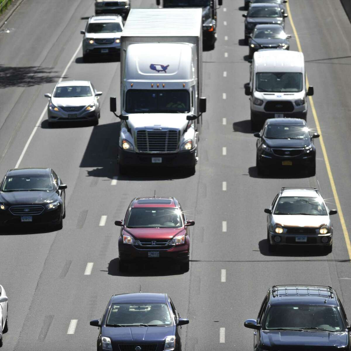 Traffic builds in the early Friday afternoon on eastbound I-84 past exit 5, in Danbury.
