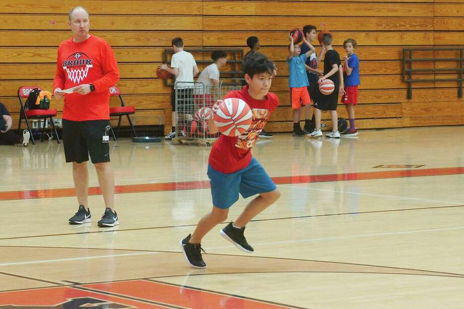 Clear Brook basketball coach Nathan Janak observes as Alex Daniel participates in a dribbling drill at the Clear Brook summer basketball camp. Photo: Kirk Sides / Staff Photographer / © 2019 Kirk Sides / Houston Chronicle
