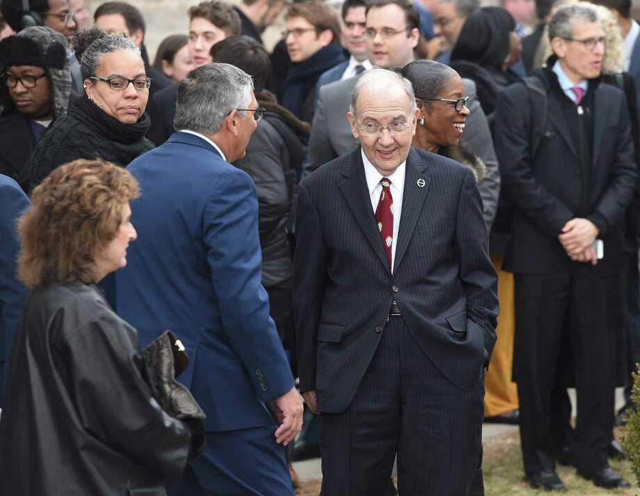 President Pro Tempore of the Connecticut State Senate Martin Looney (center) speaks with Republican State Senator Len Fasano (back to camera) outside of the Governor William A. O'Neill Armory after the swearing in ceremony for Governor Ned Lamont in Hartford on January 9, 2019. Photo: Arnold Gold / Hearst Connecticut Media / New Haven Register