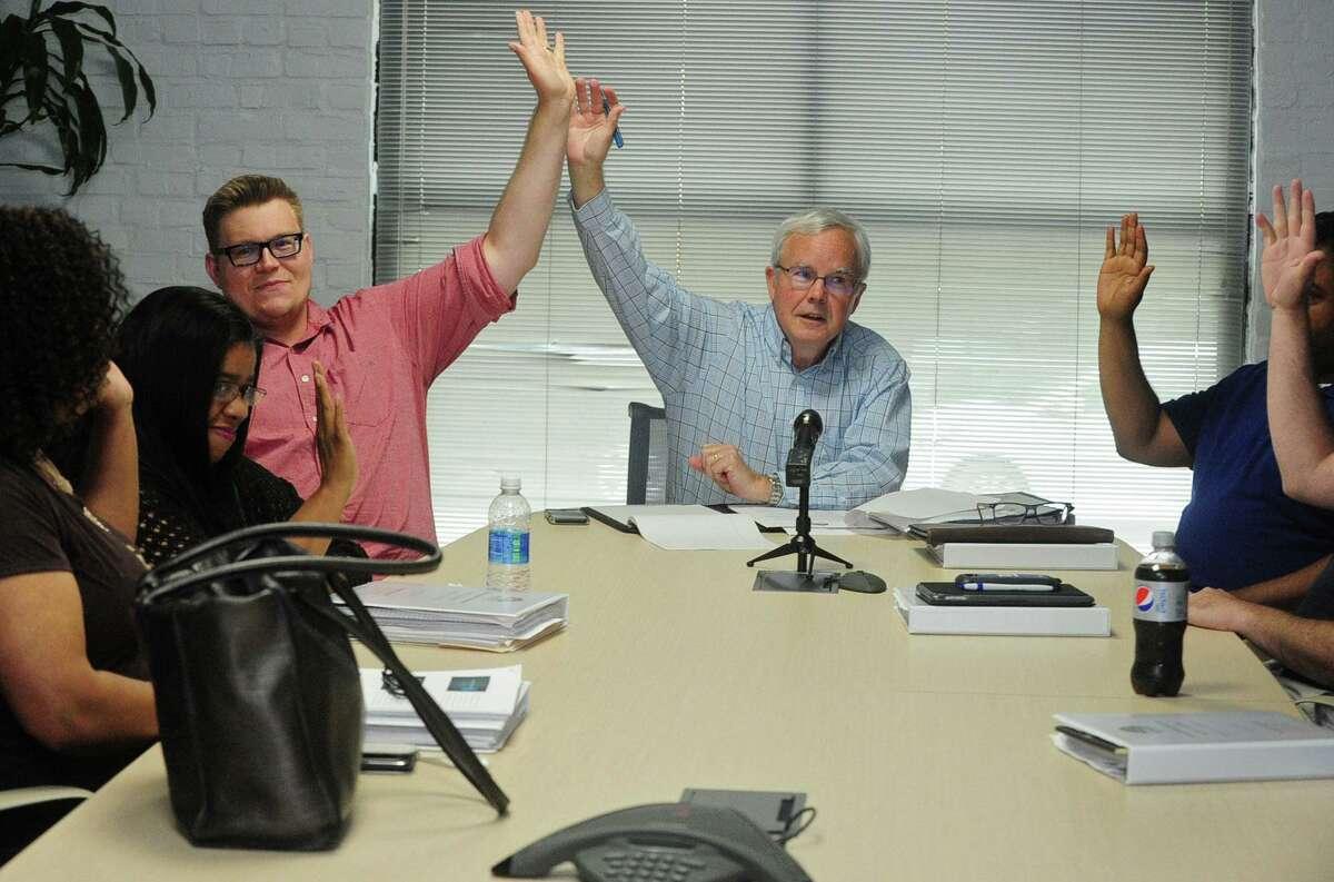 Norwalk Board of Education members Erik Anderson and Michael Lyons.