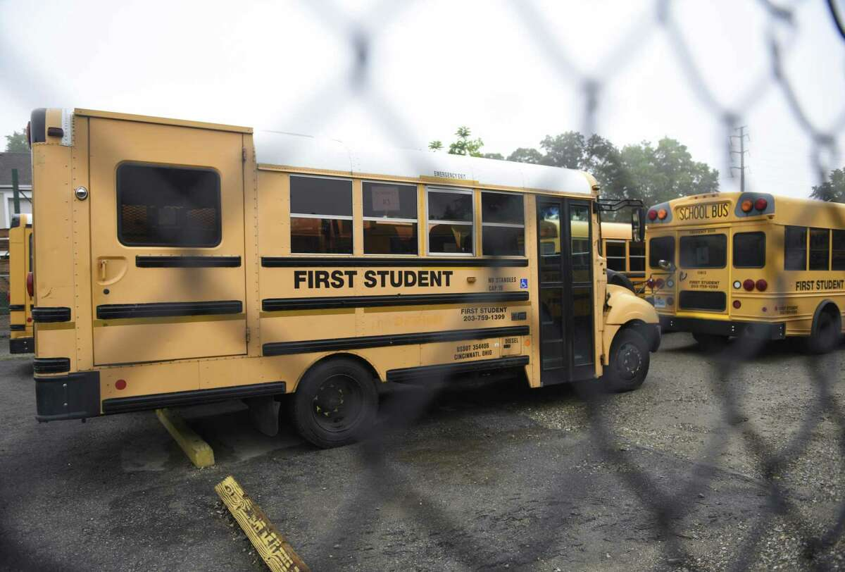 Buses are parked at the First Student bus depot in Stamford, Conn. Thursday, June 20, 2019. Beach-goers have repeatedly complained about noise and fumes from school buses training new drivers in the parking lot along the marina at Cummings Beach. First Student was earlier kicked out of the Cove Island parking lot for safety concerns and operating without a permit.