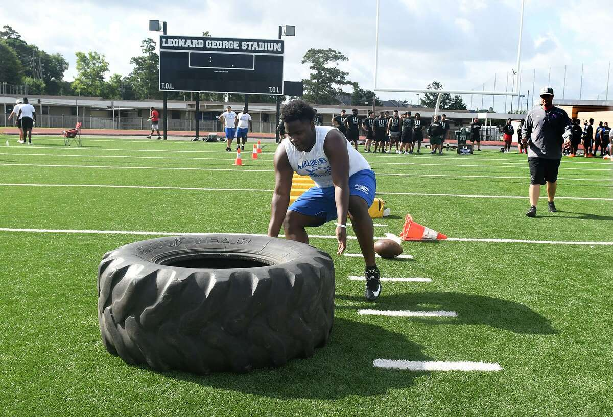 Jontrell Casimere, a Dekaney High School junior, works through the obstacle course during the War Zone Lineman Challenge at Spring High School on June 15, 2019.