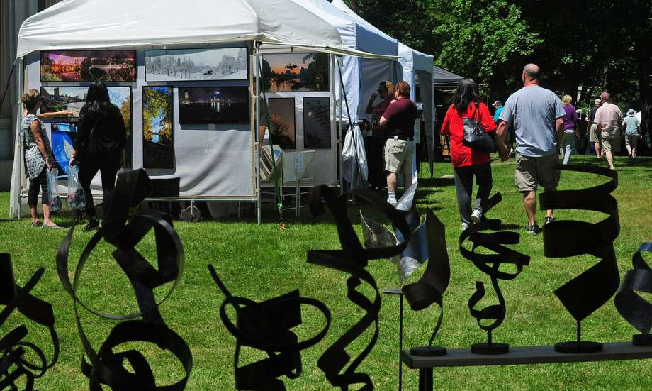 More than100 juried artisans showing one-of-a-kind ceramics, wearable art and a huge array of other fine arts and crafts will be featured at the seventh annual Norwalk Art Festival June 29 and 30 at Mathews Park. Photo: Hearst Connecticut Media File Photo / Norwalk Hour