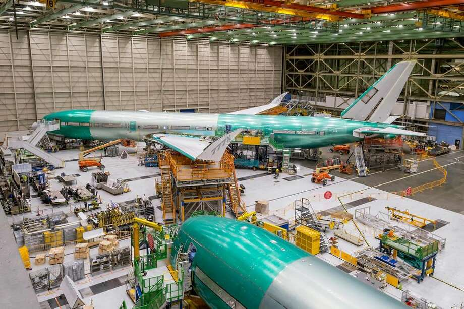 The 777x under construction in Boeing's factory with the wingtips folded up. Photo: Boeing