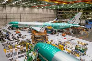 The 777x under construction in Boeing's factory with the wingtips folded up.