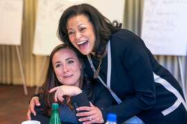 Nicole Taylor, right, new CEO of the SIlicon Valley Community Foundation, hugs Kendra Onishi, left, during a staff luncheon at the Elks Lodge on Wednesday, June 19, 2019, in Palo Alto, Calif.