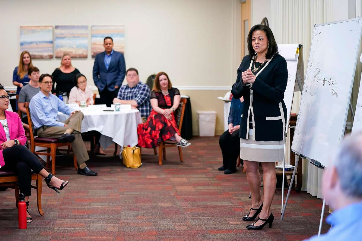 Nicole Taylor, new CEO of the SIlicon Valley Community Foundation, talks with her staff during a luncheon at the Elks Lodge on Wednesday, June 19, 2019, in Palo Alto, Calif.