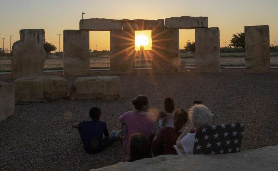 People gather to watch the sunrise for summer solstice on Friday, June 21, 2019 at the Stonehenge Replica at the University of Texas of the Permian Basin.  Jacy Lewis/Reporter-Telegram Photo: Jacy Lewis/191 News