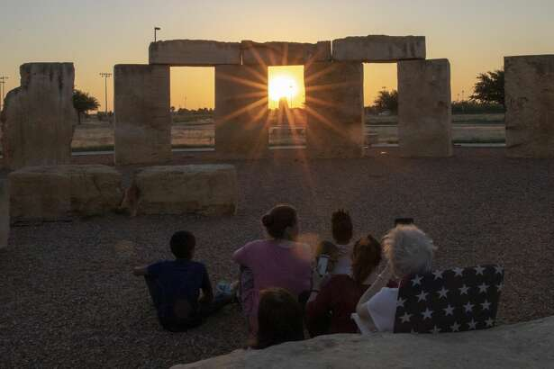 People gather to watch the sunrise for summer solstice on Friday, June 21, 2019 at the Stonehenge Replica at the University of Texas of the Permian Basin. Jacy Lewis/Reporter-Telegram