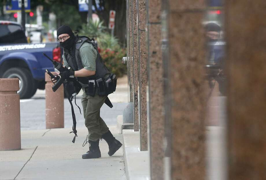 An armed shooter (shown) attacks at the Earle Cabell federal courthouse Monday morning, June 17, 2019 in downtown Dallas, Texas. Law enforcement returned fire and the shooter was hit by gunfire. No officers or citizens were injured. (Tom Fox/Dallas Morning News/TNS)  NO MAGAZINE SALES MANDATORY CREDIT; NO SALES; INTERNET USE BY TNS CONTRIBUTORS ONLY Photo: Tom Fox, MBR / TNS / Dallas Morning News