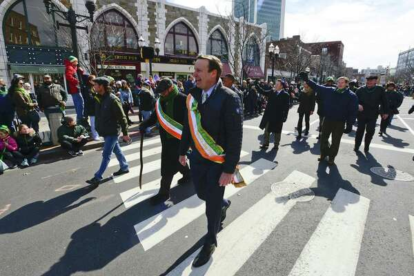 Senator Chris Murphy (D-CT) waves to the crowd lined up along Bedford Street during the City of Stamford's St. Patrick's Day Parade on Saturday, March 3, in Stamford. Murphy was the 2018 Grand Marshal for the event. Nominations are being sought for the 2020 Grand Marshal.