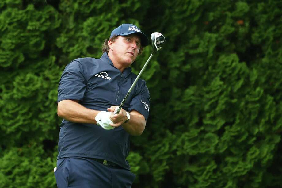Phil Mickelson plays his shot from the ninth tee during Friday's second round of the Travelers Championship at TPC River Highlands in Cromwell. Photo: Tim Bradbury / Getty Images / 2019 Getty Images