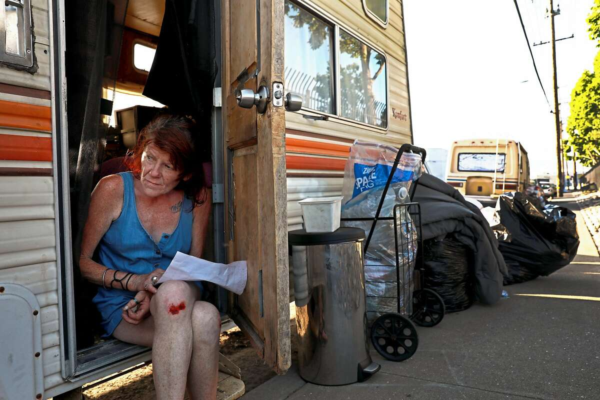 Eileen Mulcahy, 57, sits in her RV near 85th Ave. and Baldwin St. in Oakland, Calif., on Thursday, June 20, 2019. The number of people living in their vehicles in Oakland has increased by 131% over the last two years.