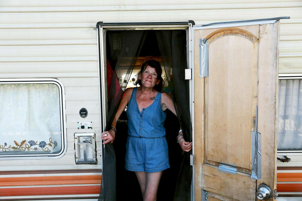 Eileen Mulcahy, 57, stands in her RV near 85th Ave. and Baldwin St. in Oakland, Calif., on Thursday, June 20, 2019.