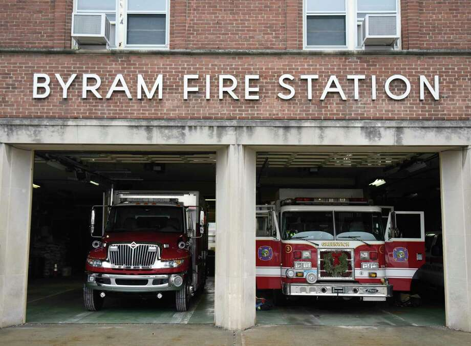 Fire trucks are parked inside the Byram Volunteer Fire Department in the Byram section of Greenwich, Conn. Thursday, Jan. 12, 2017. The building has been in need of repairs for years and funding for it will again be considered in July as money is set aside but needs to be approved. Photo: Tyler Sizemore / Hearst Connecticut Media / Greenwich Time