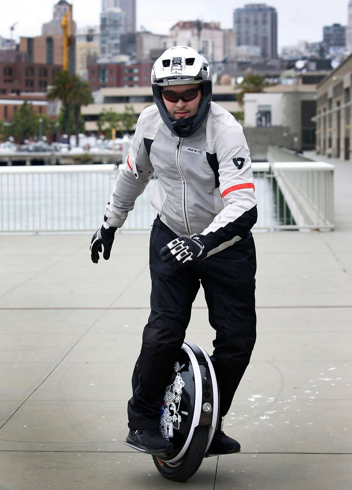 Kevin Grandon prepares for a weekly 23-mile group ride by members of Bay Area Esk8 at Pier 15 in San Francisco, Calif. on Saturday, June 15, 2019. Electric unicycles have become a popular mode of transportation.