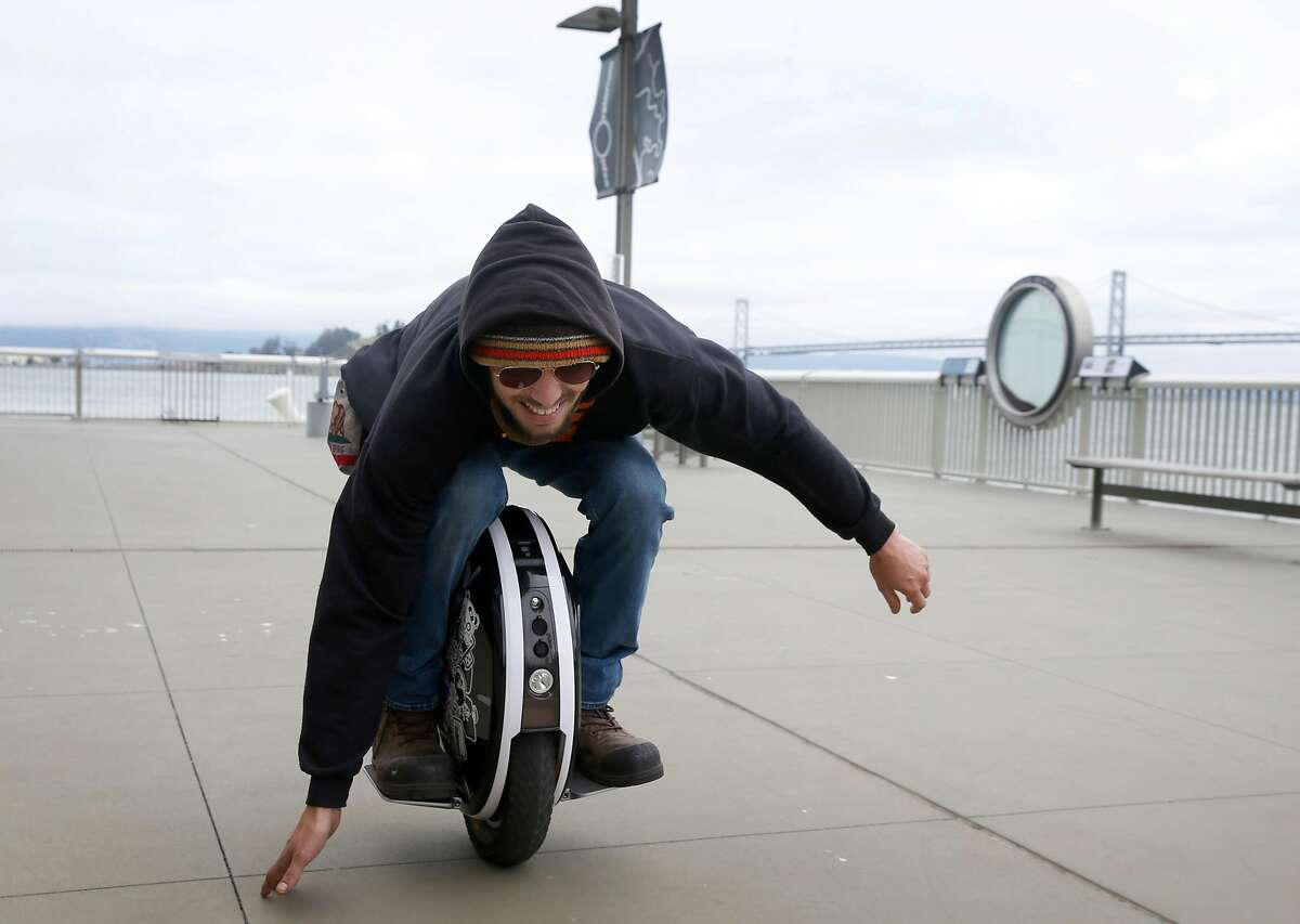 Anthony Vano rides low to the ground aboard an electric unicycle at Pier 15 before a weekly 23-mile group ride by members of Bay Area Esk8 in San Francisco, Calif. on Saturday, June 15, 2019. Electric unicycles have become a popular mode of transportation.
