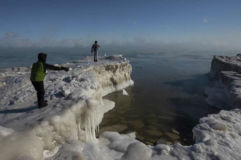 Where O. Ricardo Pimentel is heading. A young boy tosses a chunk of snow into Lake Michigan Jan. 30 in Milwaukee. But Pimentel says he will be warmed by the love he will always have for San Antonio and Texas. Photo: Jeffrey Phelps /Associated Press / FR59249 AP