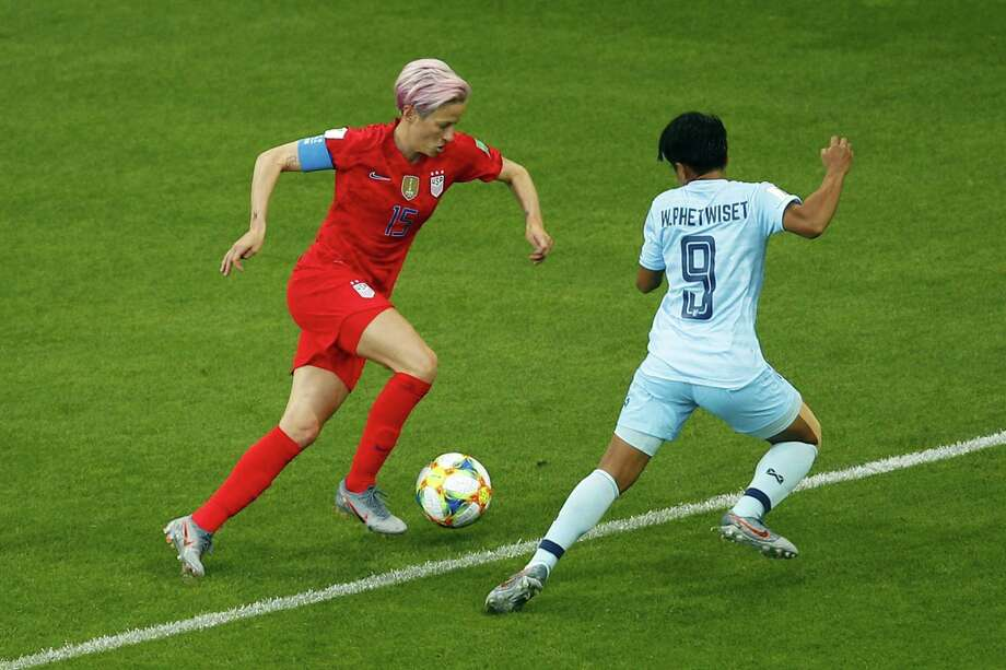 United States' Megan Rapinoe, left, runs with the ball front of Thailand's Warunee Phetwiset during the Women's World Cup Group F soccer match between the United States and Thailand at the Stade Auguste-Delaune in Reims, France, June 11. It was a 13-0 rout, the U.S. winning. Photo: Francois Mori /Associated Press / Copyright 2018 The Associated Press. All rights reserved.