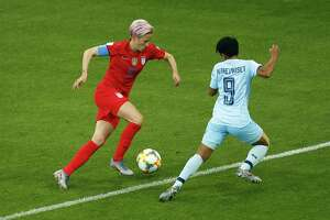 United States' Megan Rapinoe, left, runs with the ball front of Thailand's Warunee Phetwiset during the Women's World Cup Group F soccer match between the United States and Thailand at the Stade Auguste-Delaune in Reims, France, June 11. It was a 13-0 rout, the U.S. winning.