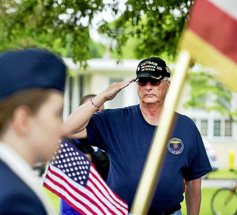 A reader suspects tensions with Iran may be a deception like the Gulf of Tonkin. Like the reader, this Navy veteran in Milford, Conn., who served in the Gulf of Tonkin, remembers those who died in Vietnam. Photo: Digital First Media File Photo