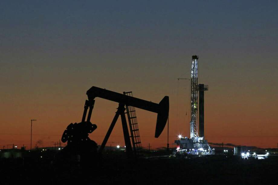 An oil rig and pump jack in Midland, Texas last year. The crude from the Permian Basin is uniquely suited for new mandates for cleaner fuels for shipping. Photo: Jacob Ford /Associated Press / Odessa American