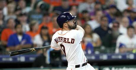 Houston Astros' Jack Mayfield hits a double against the Chicago Cubs during the second inning of a baseball game Monday, May 27, 2019, in Houston. (AP Photo/David J. Phillip)
