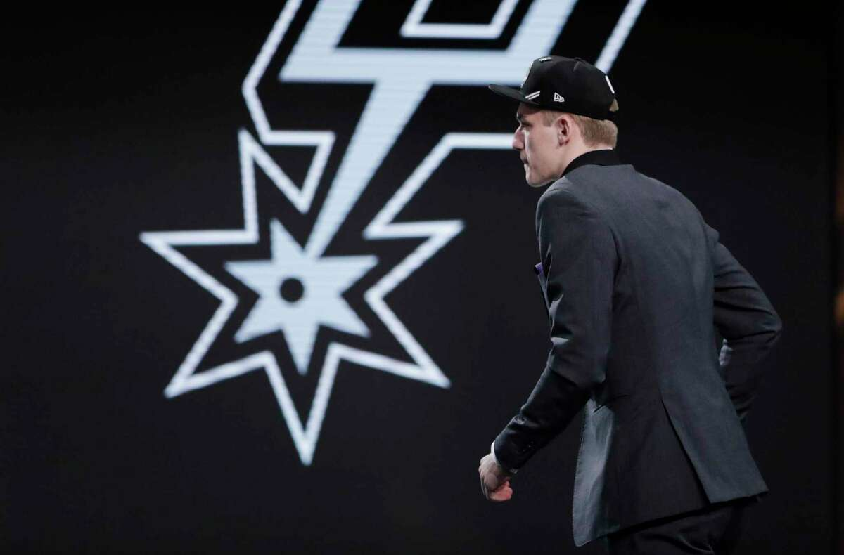 Luka Samanic, of Croatia, walks onstage after the San Antonio Spurs selected him as the 19th overall pick in the NBA basketball draft Thursday, June 20, 2019, in New York. (AP Photo/Julio Cortez)