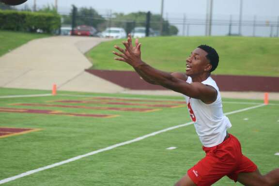 A South Houston receiver watches a pass just elude his arms near the end zone Thursday night.