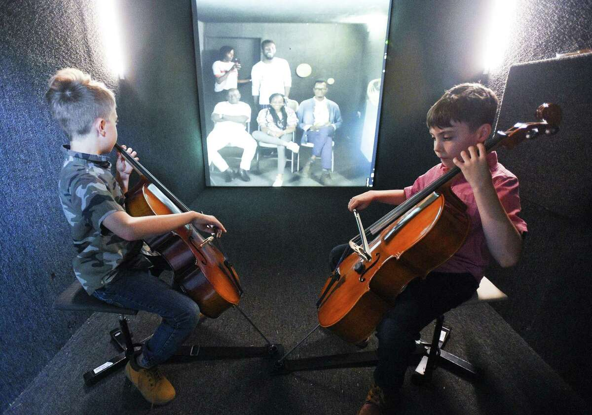 Twins William and Alexander Gray of Darien accompanied Semilore Oludipe, a musical artist from Lagos, Nigeria, on their cellos during Stamford's Make Music Day on Friday.