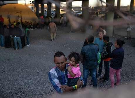 People are held by U.S. Customs and Border Protection in an enclosed area beneath the Paso del Norte International Bridge in El Paso, Texas, March 29, 2019.