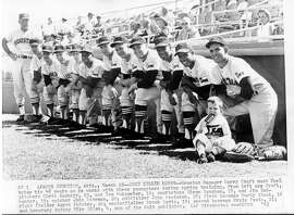 MARCH 22, 1963 - Houston Colt 45s Manager Harry Craft must feel twice his 48 years as he works with these youngsters during spring training.From left are Craft, pitchers Chris Zachary, 19, and Tom Burgmeier, 19; shortstops Glenn Vaughan, 18, and Jim Todhunter, 19; catcher John Bateman, 20; outfielder John Paciorek, 18; first baseman Rusty Staub, 18; right fielder Aaron Pointer, 20; centerfielder Brock Davis, 19; second baseman Ernie Fazio, 21; and honorary batboy Mike Giles, 4, son of the Colt publicist. (AP Wirephoto) dwc60700