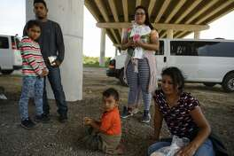 Two Honduran mothers and their children wait with other migrant families with Border Patrol supervision in McAllen, Texas, on June 20, 2019. MUST CREDIT: Washington Post photo by Carolyn Van Houten