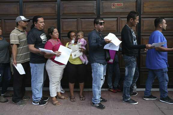 Migrants line up early for an opportunity to secure an appointment with the Mexican Commission of Assistance to Refugees, (COMAR), in Tapachula, Mexico, Monday, June 17, 2019. Officials handed pieces of paper with a time and date indicating their appointment to plea their case for a humanitarian visa. The visa allows them to stay in the country without the fear of getting deported. Tapachula is in the state of Chiapas and is about 10 miles from the border with Guatemala.