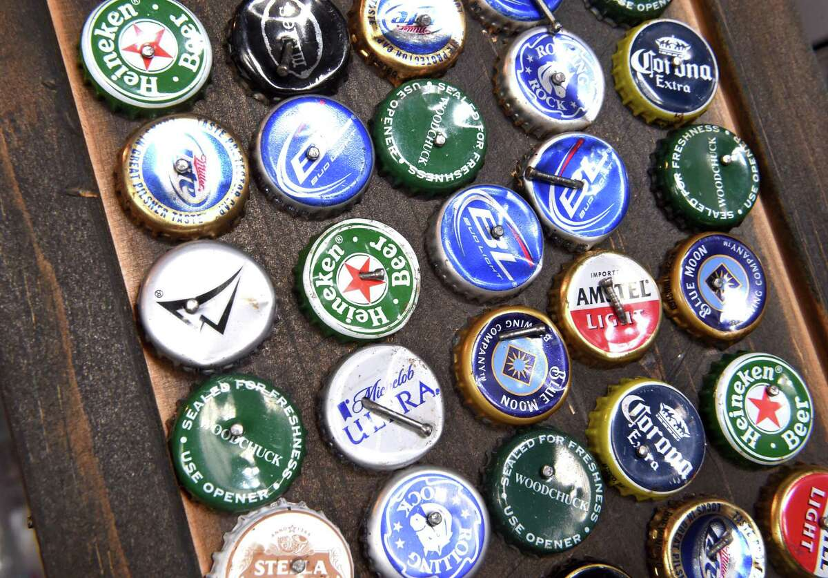 Beer bottle caps decorate a column Inside the Blue Horse in West Haven.