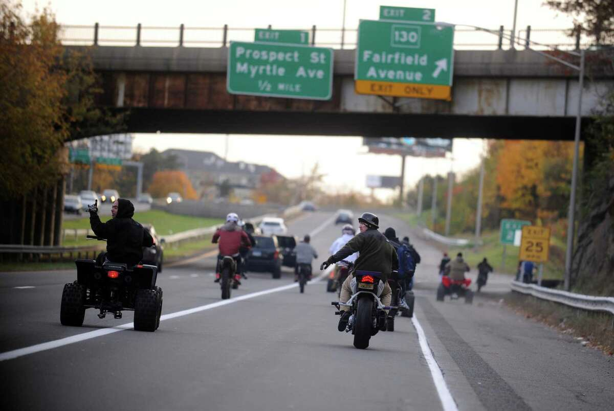 Dozens of riders on ATVs, dirtbikes and street bikes wreaked havoc across Bridgeport Saturday, Nov. 8, 2014 while evading cops and speeding through city streets.