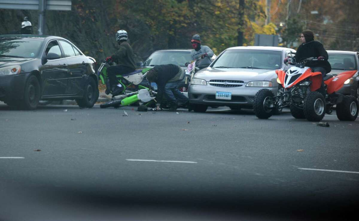 Dozens of riders on ATVs, dirt bikes and street bikes wreaked havoc across Bridgeport Nov. 8, 2014, while evading cops and speeding through city streets.