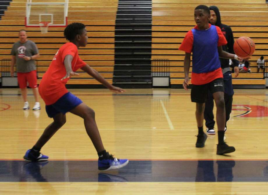 The Atascocita boys basketball camp was held for four days. Future Eagles got to practice with head coach David Martinez and his coaching staff Photo: Marcus Gutierrez Staff Photo