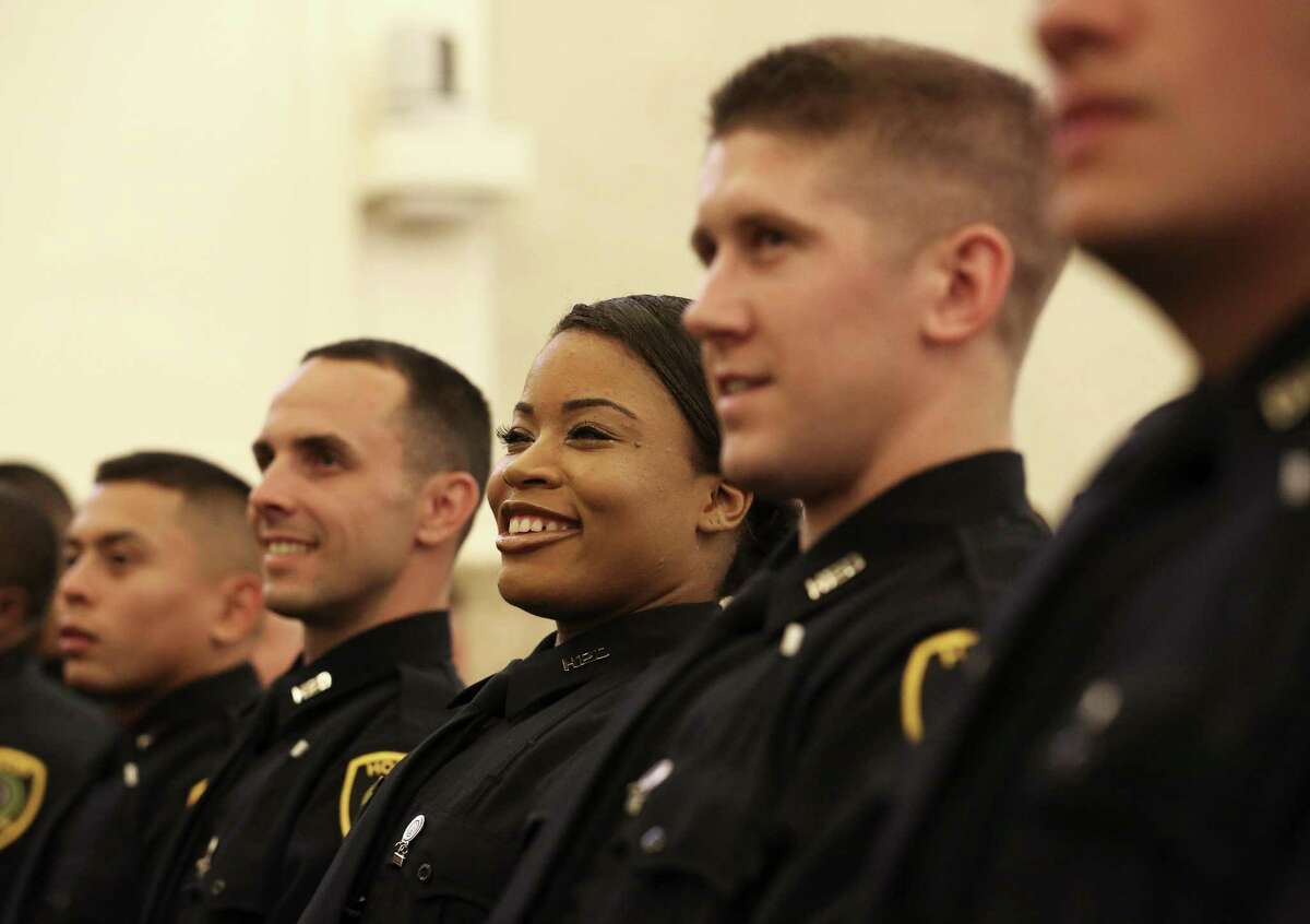 Houston Police Academy Class 230 graduating cadets listening to their class president giving a speech during graduation ceremony at St. Lukes United Methodist Thursday, May 11, 2017, in Houston. ( Yi-Chin Lee / Houston Chronicle )