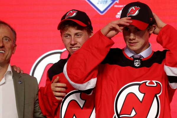 VANCOUVER, BRITISH COLUMBIA - JUNE 21: Jack Hughes smiles after being selected first overall by the New Jersey Devils during the first round of the 2019 NHL Draft at Rogers Arena on June 21, 2019 in Vancouver, Canada. (Photo by Bruce Bennett/Getty Images)