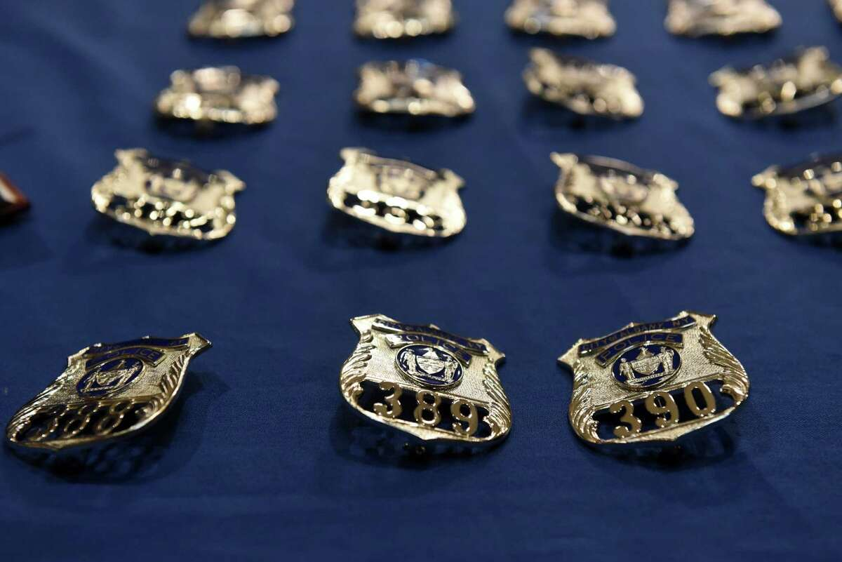 Badges for 21 newly hired Albany police officers are placed on a table during a swearing-in ceremony on Friday, June 21, 2019, at City Hall in Albany, N.Y. The class of 21 will now enter the city's training academy. (Will Waldron/Times Union)