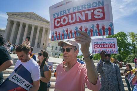 Immigration activists rally outside the Supreme Court on April 23, 2019, as the justices hear arguments over the Trump administration's plan to ask about citizenship on the 2020 census, in Washington. . The plaintiffs, who successfully challenged the question in a Maryland federal court.